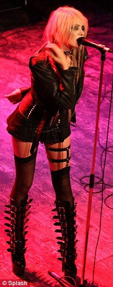 Stage style: The 17-year-old also wore the boots on-stage as she performed with her band Pretty Reckless over the weekend in Canada