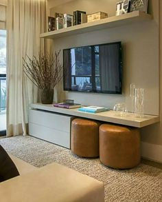 Incorporating a larger tv into your decor.  Like the shelves and has sock storage.