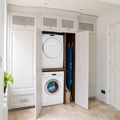Small utility room with built-in appliances and bespoke cabinetry