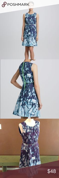 T Tahari dress T Tahari Tyra Printed Fit-and-Flare Dress, size 10. Colors: navy, light blue, white with neon green contrasting trim. Allover printed dress of cotton/spandex. Round neckline; contrast piping at high waist; back zip with contrast trim.; two side pockets; lined. Pre-worn, only twice. Retail price: $148. Asking price: $30. T Tahari Dresses
