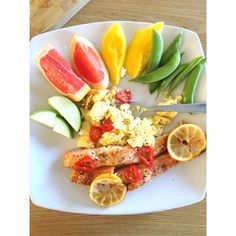 25 mins total time. Pre heat oven to 180'c 2 salmon fillets seasoned in 1/2 tsp cayenne pepper, 1/2 tsp ground pepper, 1/2 tsp chilli flakes, 1/2 lemon juice. Grilled for 18-20 minutes Apple, grapefruit, mango & sugar snaps. With 3 eggs (2 egg whites 1 egg) scrambled in the frying pan with 1/2 tsp coconut oil & 1/2 tsp olive spread. Half a chilli to serve