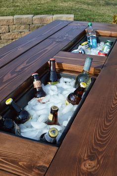 Build a DIY patio table with a drink cooler and matching benches. The built-in ice boxes are covered when not in use, making a perfect picnic table for outdoor dining. Outdoor Projects, Projects For Kids, Wood Projects, Recycling Projects, Project Ideas, Cool Woodworking Projects, Best Man Caves, How To Make Everything, Man Cave Diy