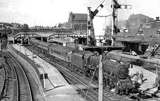 Rotherham Masborough Station looking north in 1963. The train is the 10:15 Edinburgh Waverly via Carlisle - London St Pancras, with Stanier Class 5 No. 44871.