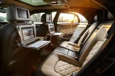 The rear of the car is where it really shines: Quilted massaging seats recline or tilt forward so you can use the computer and media system.