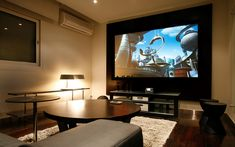 Interior, Astonishing Home Entertainment Room Inspirations: Wall Mounted TV With Wooden Coffee Table And Grey Sofa