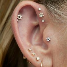 Triple Forward Helix and gold flowers all over her ear! - Imgur
