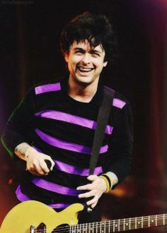 I love his smile & that neon purple stripped shirt!❤️