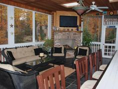 The bar on RMSer duboserm's back porch offers seating for four. RMSer duboserm's back porch has two TVs, one for the adults and one for the kids. - Gorgeous Patios and Decks From Rate My Space on HGTV