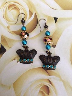 Sunday Earring Challenge. Earrings made with blackened brass crown stampings, Czech crystals, glass pearls and rhinestone chain. Design by Renie Hoffman