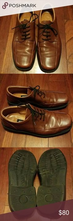 Men's Ecco Shoes Size 43 EUR (US 10) Ecco Oxford dress shoes. Cognac color, size 43 EUR (10 US). Worn a few times but still in good shape. Leather has some minor discoloring/cosmetic scratches but nothing serious  (see pictures). Shoes re-boxed (not in original Ecco shoe box).  #mensfashion     #ecco     #shoes     #comfortable Ecco Shoes Oxfords & Derbys