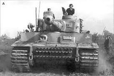 """A Panzer VI """"Tiger"""" of 505 ° Scwere Panzer Abteilung (Heavy Tank Battalion), note the barbed wire put the sides of the tank to prevent the enemy infantry go up on the tank and throw hands grenade in. Tiger Ii, Tiger Cubs, Bear Cubs, Army Vehicles, Armored Vehicles, Ferdinand Porsche, Military Photos, Military History, Tiger Tank"""
