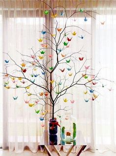 Colorful Origami Tree Branches Decoration Ideas / http://www.himisspuff.com/origami-wedding-ideas/3/