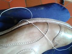 stitching the outsole and welt together