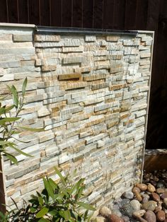 Outdoor water wall featuring Oyster Split Face Slate Maxi panel #naturalstone #gardendesign #featurewall #waterfeature