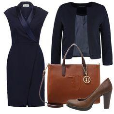 Vestito super femminile grazie allo scollo incrociato che accompagna mettendo in evidenza il décolleté con molta discrezione, blazer blu, scarpa con tacco da giorno e borsa capiente in cuoio.