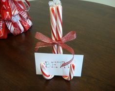 Easy to make table setting by tying a ribbon around candy canes