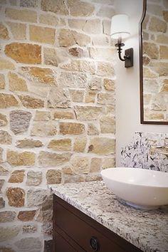 This interior stone wall is a stunning example of an interior stone veneer idea using Highland Scotch Siena Fieldlege veneer stone masonry for the acc. Stone Masonry, Stone Veneer, Brick And Stone, Stone Tub, Stone Wall Design, Stone Accent Walls, Natural Stone Wall, Stone Bathroom, Design Bathroom