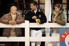 French-Greek Athina Onassis (R) and her husband Brazilian Alvaro Affonso de Miranda Neto (C), known as Doda, talk with equestrian legend Neco Pessoa (L), 24 Februray 2006 during the second day of the Jumping of Hasselt.