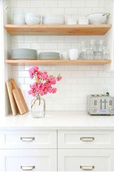 White kitchen cabinets, white worktop, white subway tiles and open wood shelves Kitchen Shelves, Diy Kitchen, Kitchen Dining, Kitchen Decor, Open Shelves, Kitchen White, Kitchen Ideas, Timber Shelves, Glass Shelves