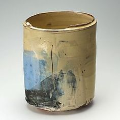 This is a large thrown and altered slipware pot by Barry Stedman using a red earthenware body.