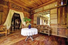 OLD wood, capiz windows, callado tracery are showcased in the parlor Filipino Architecture, Philippine Architecture, Asian Interior, Home Interior Design, Rest House, My House, Filipino House, Bamboo House Design, Philippine Houses