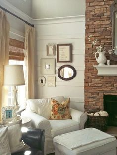 Cozy Cottage Living Room with wall gallery display. Home decorating, design, & decor.