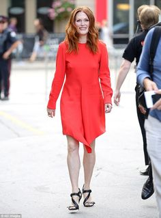 Lady in red: Julianne Moore proved she's still got it as she strutted out at the Toronto International Film Festival on Tuesday
