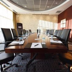 The meeting room is the main type of room where meetings, conferences, presentations and other important events are held. Selection and placement of furniture can significantly aff Multipurpose Hall, Slide Images, Rooms For Rent, Types Of Rooms, Heating Systems, Light Shades, Building, Table, Factors