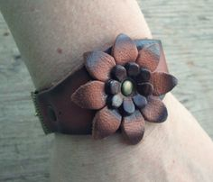 Leather flower cuff  by EarthChildArt https://www.etsy.com/listing/177628888/leather-flower-cuff-wide-bracelet?ref=shop_home_active_4