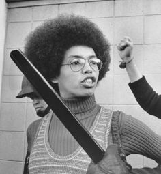 Fania Jordan, sister of Angela Davis appears to be addressing a deputy sheriff's club, following her arrest here 1/31. Miss Jordan and 16 other persons were arrested for violating tough regulations against demonstrations outside the Santa Clara County Courthouse where pre-trial motions were being heard in the Angela Davis murder kidnapping conspiracy case.