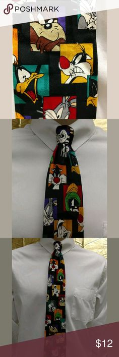 """Looney Tunes Character 60"""" Necktie Thanks for stopping by to shop today!? You are viewing a Looney Tunes Mania Character Men's Necktie.? This silk tie is 60"""" of FUN!? Characters on this tie include: Bugs Bunny, Taz, Daffy Duck, Marvin The Martian, and more! ? This tie is an exciting addition to your wardrobe.? This item is in excellent used condition.? There are no rips, stains, or tears, and it comes from a smoke free, pet free home.? Item is sold AS IS. Please review the photos. Don't…"""