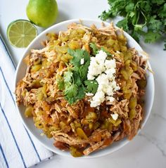 Slow cooker pork cooked in orange juice, lime juice, jalapenos, chilies and spices. Taco topped with guacamole and cilantro. Slow Cooker Pork, Slow Cooker Recipes, Cooking Recipes, Cooking Time, Pork Recipes, Lunch Recipes, Chicken Recipes, Mexican Salsa Recipes, Mexican Meals