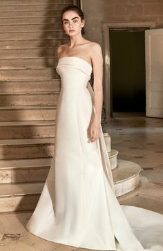 de5813e2e1f5b Strapless Hunter wedding gown with customizable bow from the Carolina  Herrera Spring 2019 Bridal Collection.
