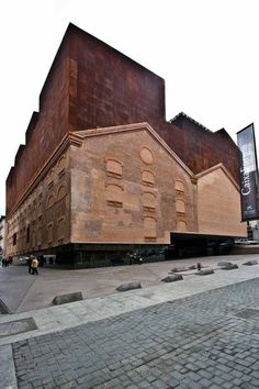 caixa forum - herzog & de meuron - Madrid The CaixaForum arts centre, which opened earlier this year in Madrid, Spain, incorporates walls from a power station that previously occupied the site. It includes galleries, administrative offices and a restauran Architecture Design, Amazing Architecture, Contemporary Architecture, Jacques Herzog, Habitat Collectif, Adaptive Reuse, Built Environment, Old Buildings, Exterior Design