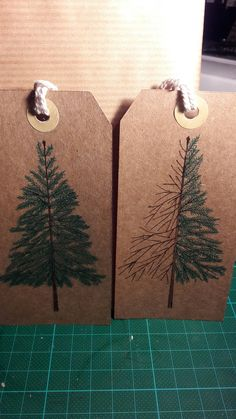 Christmas tree tags in the making.  Hand Drawn on brown parcel tags.