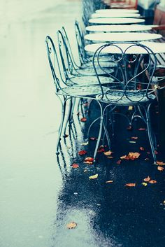 wet streets, wet cafe chairs