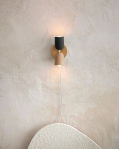 Up/Down wall sconce by In Common With x Domicile Color / material: Beige ceramic, Forest ceramic, Brass Dimensions: tall *Made to order, please allow weeks for production Living Room Modern, Home And Living, Living Spaces, Living Rooms, Task Lamps, Concrete Floors, Home Lighting, Wall Sconces, Wall Lights