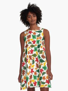Brightly colored whismical mask design on a summery dress. Loose swing shape for an easy, flowy fit Polyester / Elastane woven dress fabric with silky handfeel A-Line dresses are made in the U. Grafik Art, Ikat Pattern, Pattern Dress, Pattern Design, Motif Design, Abstract Pattern, Vintage T-shirts, Vintage Roses, Vintage Style