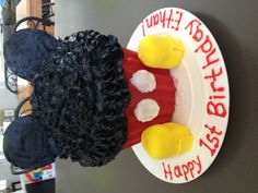 Homemade Mickey birthday cake made by using the giant Wilton cupcake pan.  Fair warning, black icing stains EVERYTHING!  ;)