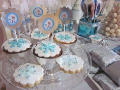 Fondant topped cookies and cupcakes at a Frozen birthday party! See more party ideas at CatchMyParty.com!