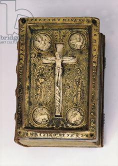 Ms 16/1143 Cover of 'Quatuor Evangelia' depicting Christ on the cross and the symbols of the evangelists, from Werden Abbey (bronze, ivory & wood), 12th century