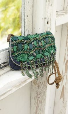 Denim and Malachite Purse - I like the stone embroidery, hate the chains and... the bag, really. But the malachite embroidery is nice :-D