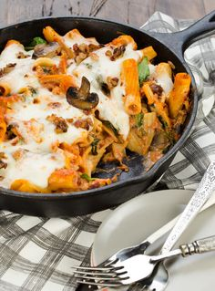 Cheesy Skillet Rigatoni is filled with cheese, pancetta and mushrooms! An easy weeknight meal that is also perfect comfort food for chilly fall nights. ~ http://www.garnishwithlemon.com
