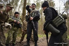 Ukrainian and American soldiers share a laugh during training to detect improvised explosive devices during the Fearless Guardian exercise in Yavoriv, Ukraine, on April 21, 2015. (Joshua L. DeMotts/Stars and Stripes)