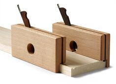I don't like grooving small drawer and tray parts at the router table or tablesaw. So I made a pair of small grooving planes to do it instead.
