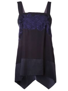 Ink black silk crepe tunic from Akira featuring blue embroidery in the front and contrast panels at the hem.