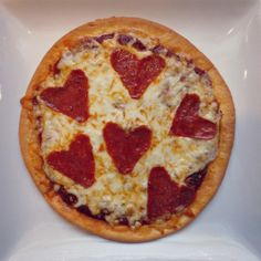 Who said pizza wasn't romantic!? Click for our #glutenfree Heart Warming Pizza recipe!