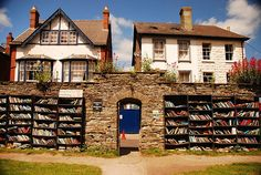The Honest Bookshop' in Hay on Wye, Wales, UK. People who want to buy something are left to deposit their money in a cashbox (50p for a hardback, or 30p for a paperback).