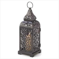 Moroccan Tower Candle Lantern by Furniture Creations, http://www.amazon.com/dp/B003UYHO84/ref=cm_sw_r_pi_dp_shzRpb08BVQTF