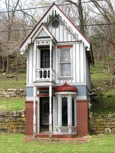 Oh, how cute! Great details and built into the hill.  Too small to be really practical, but cute nonetheless.